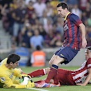 CORRECTING NAME OF GOALKEEPER TO THIBAUT COURTOIS - FC Barcelona's Lionel Messi from Argentina, center, duels for the ball against Atletico Madrid's Filipe Luis, from Brazil, right, and goalkeeper Thibaut Courtois, left, during a final Spanish Supercup at the camp nou stadium in Barcelona, Spain, Wednesday, Aug. 28, 2013. (AP Photo/Manu Fernandez)