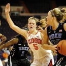 Duke's Tricia Liston, right, drives through the baseline while being covered by Clemson's Kelly Gramlich (5) during the first half of an NCAA college basketball game, Thursday, Jan. 24, 2013, at Littlejohn Coliseum in Clemson, S.C. (AP Photo/Richard Shiro)
