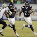 Chicago Bears running back Matt Forte (22) carries the ball against New Orleans Saints defense Chicago Bears running back Matt Forte (22) runs against New Orleans Saints defense during the second half of an NFL football game Monday, Dec. 15, 2014, in Chic