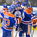 Edmonton Oilers' Ales Hemsky (83), Sam Gagner (89), Nail Yakupov (64) and Jeff Petry (2) celebrate a goal against the San Jose Sharks during the second period of an NHL hockey game Friday, Nov. 15, 2013, in Edmonton, Alberta The Associated Press