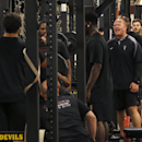 Shawn Griswold, Arizona State's head coach of sports performance for football, shouts encouragement to players as they lift weights in the football training room on Monday, July 21, 2014, in Tempe, Ariz The Associated Press