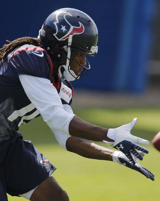 Houston Texans wide receiver DeAndre Hopkins catches a pass during a joint practice with the Denver Broncos  on Thursday, Aug. 21, 2014, in Englewood, Colo