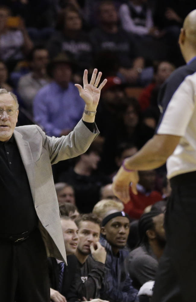 Minnesota Timberwolves coach Rick Adelman, left, argues a call during the second half on an NBA basketball game against the San Antonio Spurs, Sunday, Jan. 12, 2014, in San Antonio