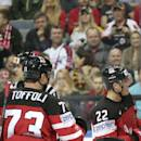 Canada's players celebrate a goal during the Hockey World Championships Group A match against Germany in Prague, Czech Republic, Sunday, May 3, 2015. (AP Photo/Petr David Josek)