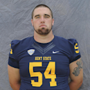 In this Aug. 2014, photo provided by Kent State University, Jason Bitsko poses during football photo day in Kent, Ohio. Kent State says Bitsko has died and that police believe he passed away from an undetermined medical issue. He was found unresponsive in the bedroom of his off-campus apartment Wednesday, Aug. 20, 2014. (AP Photo/Kent State University)
