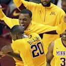 Minnesota guard Austin Hollins (20) is congratulated by Andre Hollins and Andre Ingram (30) after Austin Hollins hit 5 three-pointers against Northwestern in the second half of an NCAA college basketball game, Sunday, Jan. 6, 2013, in Minneapolis. Minnesota defeated Northwestern 69-51. (AP Photo/Andy King)