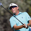 Davis Love III watches his tee shot on the 18th hole during the third round of the McGladrey Classic golf tournament on Saturday, Oct. 25, 2014, in St. Simons Island, Ga. (AP Photo/Stephen B. Morton)