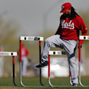 Cincinnati Reds pitcher Johnny Cueto runs agility drills during spring training baseball practice in Goodyear, Ariz., Tuesday, Feb. 18, 2014 The Associated Press