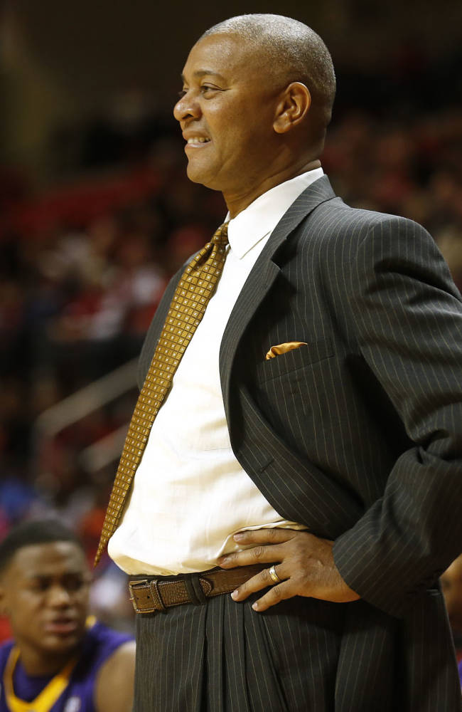 LSU coach Johnny Jones watches as his team plays Texas Tech during an NCAA college basketball game in Lubbock, Texas, Wednesday Dec. 18, 2013