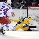 New York Rangers' Ryan Callahan (24) has the puck knocked away by Buffalo Sabres' Ryan Miller (30) during the second period of an NHL hockey game in Buffalo, N.Y., Thursday, Dec. 5, 2013 The Associated Press