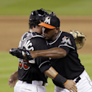 Miami Marlins catcher Jarrod Saltalamacchia, left, congratulates relief pitcher Carlos Marmol after the Marlins' 5-0 win against the San Diego Padres in a baseball game in Miami, Saturday, April 5, 2014 The Associated Press