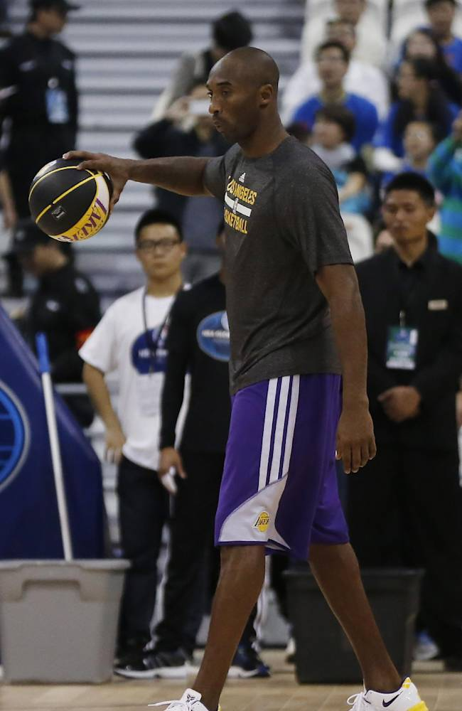Kobe Bryant of the Los Angeles Lakers warms up during the NBA Fan Appreciation Day event ahead of a 2013-2014 NBA preseason game against the Golden State Warriors in Shanghai, China, Thursday, Oct. 17, 2013. Lakers will compete against Warriors in two NBA preseason games respectively in Shanghai on Friday
