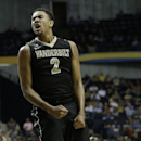 Vanderbilt guard Kedren Johnson (2) reacts after a goal against Mississippi during the second half of an NCAA college basketball game in the semifinals of the Southeastern Conference tournament, Saturday, March 16, 2013, in Nashville, Tenn. (AP Photo/John Bazemore)