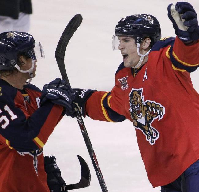 Florida Panthers' Scottie Upshall, right, celebrates with teammate Brian Campbell (51) after Upshall scored a goal during the third period of an NHL hockey game against the New Jersey Devils, Friday, March 14, 2014, in Sunrise, Fla. The Panthers won 5-3