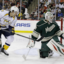 Minnesota Wild goalie Ilya Bryzgalov, right, of Russia, deflects a shot by Nashville Predators left wing Gabriel Bourque (57)during the second period of an NHL hockey game in St. Paul, Minn., Sunday, April 13, 2014 The Associated Press