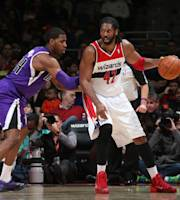WASHINGTON, DC - FEBRUARY 9: Nene #42 of the Washington Wizards handles the ball against Jason Thompson #34 of the Sacramento Kings during the game at the Verizon Center on February 9, 2014 in Washington, DC. (Photo by Ned Dishman/NBAE via Getty Images)