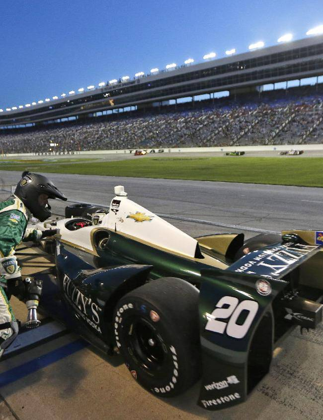 Ed Carpenter pits during the IndyCar auto race at Texas Motor Speedway in Fort Worth, Texas, Saturday, June 7, 2014