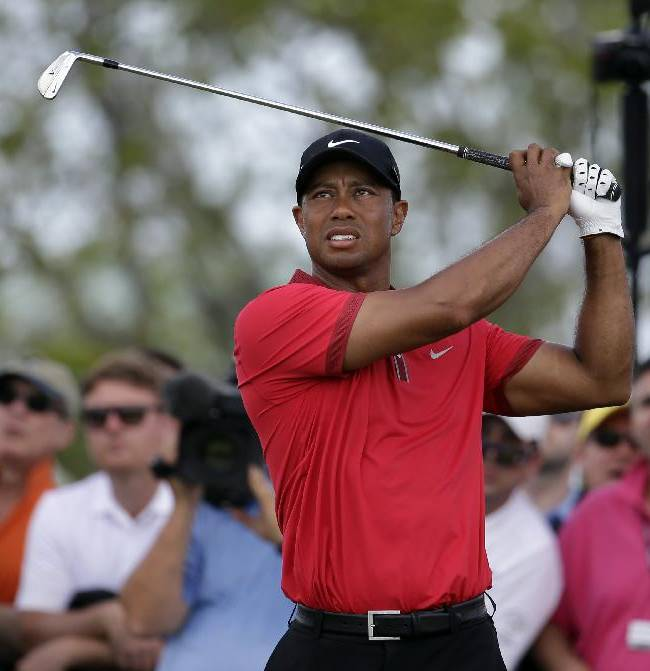 Tiger Woods tees off on the fourth hole during the final round of the Cadillac Championship golf tournament Sunday, March 9, 2014, in Doral, Fla