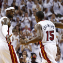 Jun 18, 2013; Miami, FL, USA; Miami Heat small forward LeBron James (6) high fives point guard Mario Chalmers (15) during the first quarter of game six in the 2013 NBA Finals at American Airlines Arena. (Derick E. Hingle-USA TODAY Sports)