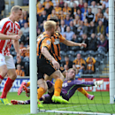 Stoke City's Ryan Shawcross, left, scores his teams first goal against Hull City, during their English Premier League match at the KC Stadium, Hull, England, Sunday Aug, 24, 2014