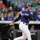 Colorado Rockies Carlos Gonzalez hits a solo home run in the first inning of a baseball game against the Chicago White Sox on Monday, April 7, 2014, in Denver The Associated Press