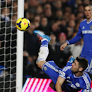 Chelsea s Gary Cahill, right, shoots to score against Southampton during their English Premier League soccer match at the Stamford bridge ground in London, Sunday, Dec. 1, 2013