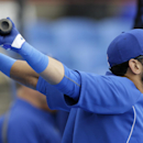 Toronto Blue Jays right fielder Jose Bautista stretches before taking batting practice before an exhibition baseball against the Tampa Bay Rays game Friday, March 7, 2014, in Dunedin, Fla The Associated Press