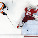 Philadelphia Flyers right wing Matt Read (24) scores past Detroit Red Wings goalie Jimmy Howard (35) in the second period of an NHL hockey game in Detroit Wednesday, Dec. 4, 2013 The Associated Press