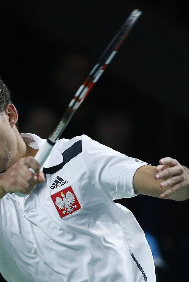 Poland's Jerzy Janowicz returns the ball against Russia's Karen Khachanov during their Davis Cup First Group tennis match in Moscow, Russia, Friday, Jan. 31, 2014