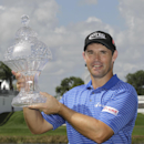 Padraig Harrington holds the trophy after winning the Honda Classic golf tournament Monday, March 2, 2015, in Palm Beach Gardens, Fla. (AP Photo/Luis M. Alvarez)