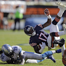 Chicago Bears wide receiver Alshon Jeffery (17) trips over Detroit Lions safety Louis Delmas (26) after making a reception during the first half of an NFL football game, Sunday, Nov. 10, 2013, in Chicago The Associated Press