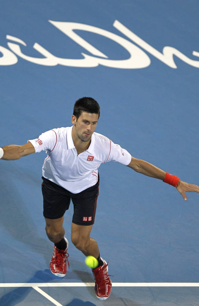 Novak Djokovic of Serbia returns the ball to Jo-Wilfried Tsonga of France during the second day of the Mubadala World Tennis Championship in Abu Dhabi, United Arab Emirates, Friday, Dec. 27, 2013