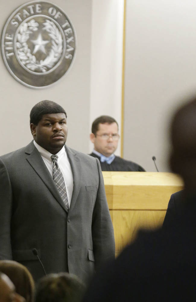 FILE - In this Jan. 10, 2014 file photo, former Dallas Cowboys' Josh Brent stands in court as potential jurors are directed into Judge Robert Burns', rear, courtroom in Dallas. Brent's trial is expected to start Monday on allegations that he was driving drunk and caused the death of his friend, college teammate and former Dallas practice squad player Jerry Brown in a December 2012 crash. (AP Photo/LM Otero, File)