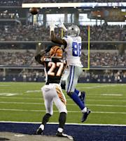 Dallas Cowboys wide receiver Dez Bryant, goes up to grab a pass for a touchdown as Cincinnati Bengals' Dre Kirkpatrick (27) defends during the first half of a preseason NFL football game, Saturday, Aug. 24, 2013, in Arlington, Texas. (AP Photo/LM Otero)