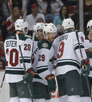 Minnesota Wilds' Jason Pominville (29) celebrates his goal with teammates Ryan Suter (20), Mikko Koivu (9), of Finland, and Zach Parise (11) during the second period of an NHL hockey game against the Detroit Red Wings Sunday, March 23, 2014 in Detroit. (AP Photo/Duane Burleson)