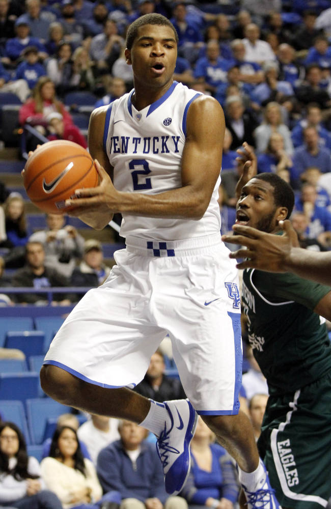 Kentucky's Aaron Harrison (2) looks for an open team mate next to Eastern Michigan's Anthony Strickland (33) during the second half of an NCAA college basketball game, Wednesday, Nov. 27, 2013, in Lexington, Ky. Kentucky won 81-63
