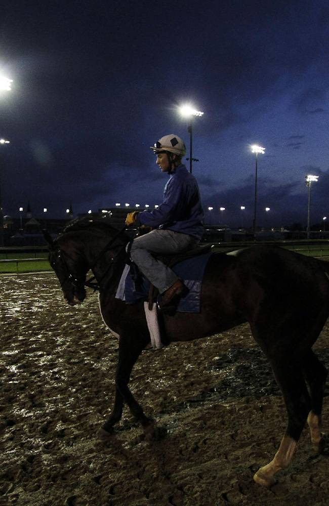 A horse goes for a morning workout at Churchill Downs Wednesday, April 30, 2014, in Louisville, Ky