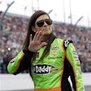 Danica Patrick waves to fans as she walks down pit road before the start of the NASCAR Daytona 500 Sprint Cup Series auto race at Daytona International Speedway, Sunday, Feb. 24, 2013, in Daytona Beach, Fla. (AP Photo/John Raoux)