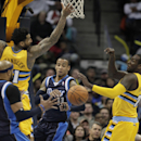 Dallas Mavericks guard Monta Ellis (11) passes between Denver Nuggets forward Wilson Chandler (21) and Denver Nuggets center J.J. Hickson (7) to Mavericks forward Vince Carter, far left, in the fourth quarter of an NBA game in Denver on Wednesday, March 5