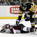 Pittsburgh Penguins' Steve Downie (23) collides with Colorado Avalanche's Tyson Barrie (4) during the second period of an NHL hockey game in Pittsburgh on Thursday, Dec. 18, 2014 The Associated Press