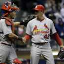 St. Louis Cardinals' Seth Manessp is congratulated by catcher Yadier Molina after the ninth inning of a baseball game against the Milwaukee Brewers Tuesday, April 15, 2014, in Milwaukee. The Cardinals won 6-1 The Associated Press