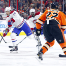 Montreal Canadiens' P.A. Parenteau (15), left, skates the puck into the zone with Philadelphia Flyers' Luke Schenn, right, watching during the first period of an NHL hockey game, Saturday, Oct. 11, 2014, in Philadelphia The Associated Press