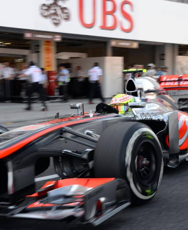 McLaren driver Sergio Perez of Mexico leaves his pit during the qualifying session for the Japanese Formula One Grand Prix at the Suzuka circuit in Suzuka, Japan, Saturday, Oct. 12, 2013