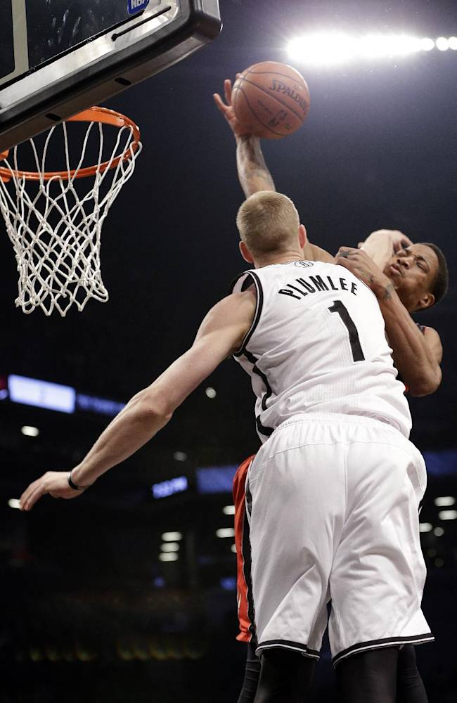 Brooklyn Nets' Mason Plumlee (1) fouls Toronto Raptors' DeMar DeRozan during the first half of Game 3 of an NBA basketball first-round playoff series Friday, April 25, 2014, in New York