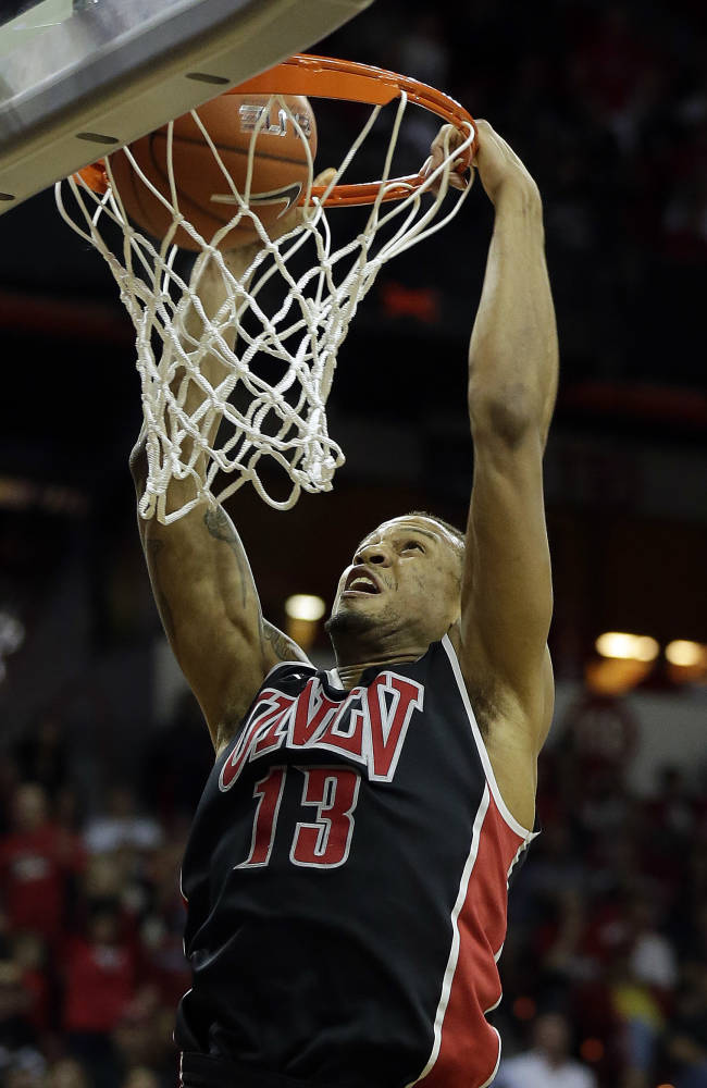 UNLV's Bryce Dejean-Jones dunks during the first half of an NCAA college basketball game against San Diego State in the semifinals of the Mountain West Conference tournament Friday, March 14, 2014, in Las Vegas