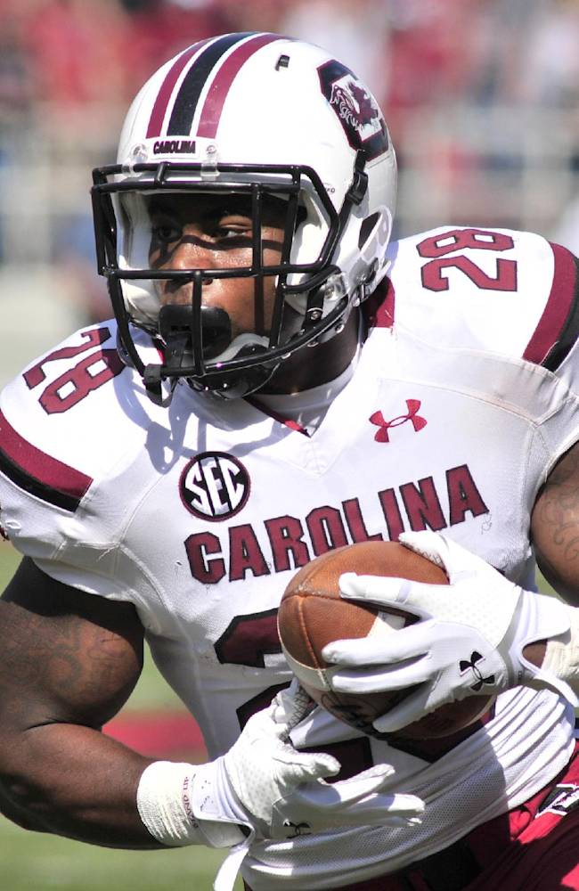 South Carolina running back Mike Davis carries the ball during the first half of an NCAA college football game against Arkansa in Fayetteville, Ark., Saturday, Oct. 12, 2013. Davis rushed for 128 yards on 19 carries in South Carolina's 52-7 win