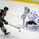 Buffalo Sabres center Zemgus Girgensons (28), of Latvia, moves the puck in front of Toronto Maple Leafs goaltender James Reimer (34) during the third period of an NHL hockey game Saturday, Nov. 15, 2014, in Buffalo, N.Y. Buffalo won 6-2 The Associated Pre