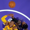 Los Angeles Lakers center Dwight Howard (12) competes for a rebound with Sacramento Kings power forward James Johnson during the first half of their preseason NBA basketball game, Sunday, Oct. 21, 2012, in Los Angeles. (AP Photo/Mark J. Terrill)