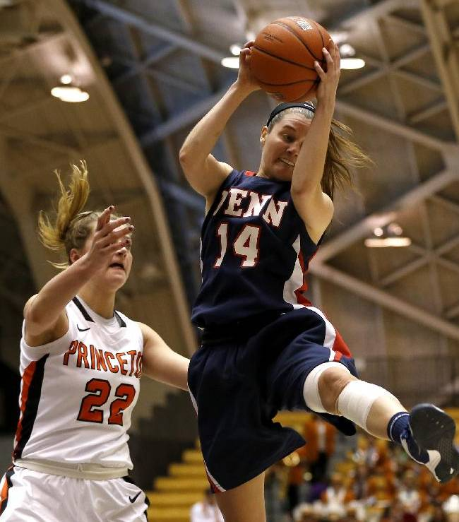 Penn guard Meghan McCullough (14) collects a rebound while Princeton forward Taylor Williams (22) challenges her during the second half of an NCAA college basketball game, Tuesday, March 11, 2014, in Princeton, N.J. Penn won 80-64