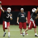 Arizona Cardinals quarterbacks Carson Palmer (3) and Drew Stanton, right, throws passes as quarterbacks coach Freddie Kitchens looks on during the first day of NFL football training camp on Saturday, July 26, 2014, in Glendale, Ariz The Associated Press
